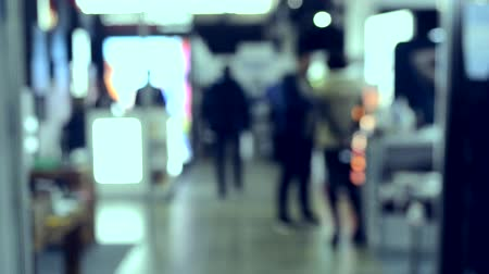 concert hall : Crowd of people inside building with illumination. Blurred Background. Crowd of people indoors. Blurred Abstract Background. City center. Blurred View of People.