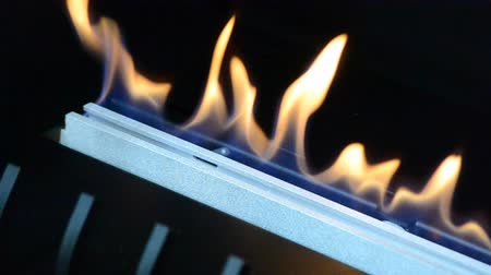 emise : One Biofireplace burn on ethanol gas. Contemporary mount biofuel on ethanol fireplot fireplace close-up. Modern smart ecological alternative technologies. Interior design of a house inside