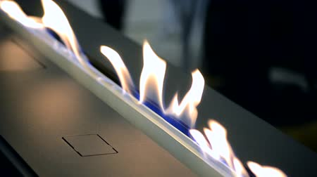fireside : Modern bio fireplot fireplace on ethanol gas. Smart ecological alternative technologies. Contemporary biofuel on ethanol close-up. Energy saving innovation. Interior inside a house Stock Footage
