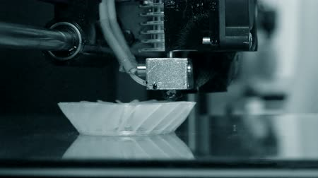 built up : 3D printer working. Fused deposition modeling, FDM. 3D printer printing an object from plastic. Automatic three dimensional 3d printer performs plastic. Progressive additive technology for 3d printing