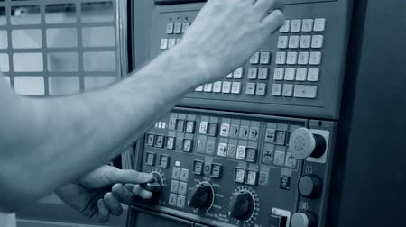 workman : Person works behind the control panel of the production machine at the factory.Industrial machinery, production aggregation and equipment mechanical automaton. Heavy machinery