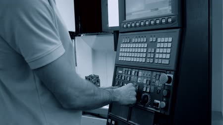 redaccion : Person works behind the control panel of the production machine at the factory.Industrial machinery, production aggregation and equipment mechanical automaton. Heavy machinery