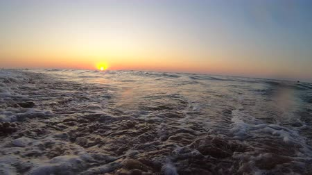 Sunset sunrise dawning at sea ocean. Water and waves sea landscape scenery country scene background on dusk sunrise dawning daybreak daylight sunset sundown dawn and sand beach. Bottom view Wideo
