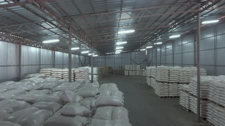 stockpile : Big industrial warehouse full of white sacks