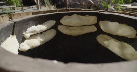 cuisine dark : Cooking traditional lavash in national oven for making a bread in Georgia. stone oven for baking a Georgian bread.