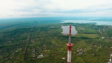 transmitter tower : Aerial 4k footage from drone flying around radio telecommunication tv tower in suburb of Stavropol Russia Stock Footage