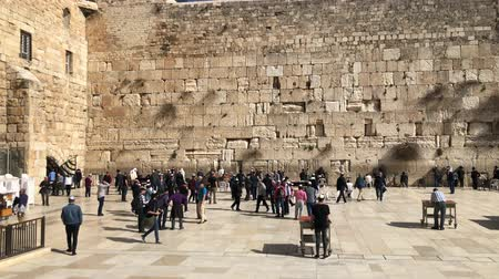 wailing : Western Wall or Wailing Wall or Kotel in Jerusalem. People come to pray to the Jerusalem western wall. The Wall is the most sacred place for all jews Stock Footage