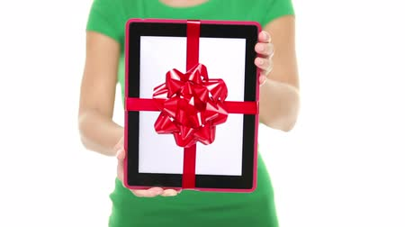 presentes : Tablet PC gift. Closeup of woman showing and giving digital tablet computer as present or christmas gift. Pure white background. Stock Footage