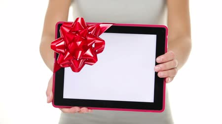 portátil : Tablet computer screen gift. Closeup of touch pad tablet computer screen with red gift ribbon. Christmas gift or present isolated on white background.