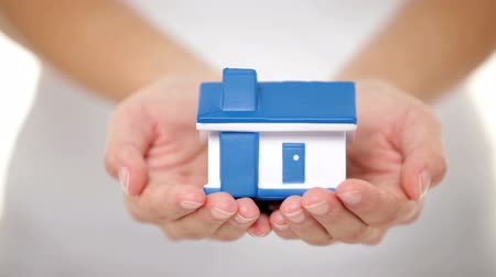 real : Home - new house concept. Woman holding model house