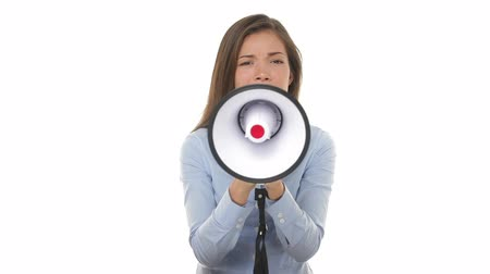 kobieta biznes : Business woman screaming angry in megaphone looking at camera yelling upset and unhappy. Young mixed race Asian Chinese  Caucasian female businesswoman on pure white background.