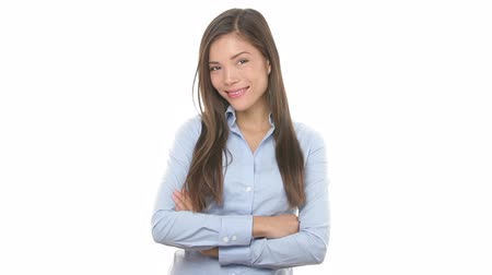smile : Young casual business woman smiling portrait. Confident happy young Asian Businesswoman professional standing with arms crossed isolated on white background. Mixed race Asian Chinese  Caucasian model