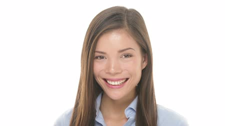 Woman smiling closeup portrait. Young business woman professional looking at camera happy. Beautiful multiethnic Asian  Caucasian female model on white background in studio.