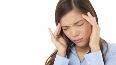 усталый : Headache stress business woman stressed with migraine looking unhappy, tired and depressed. Young casual female businesswoman on white background. Mixed race young Asian Caucasian woman.