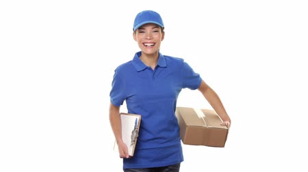 Female package delivery person. Courier giving packages in uniform. Woman courier smiling happy on white background. Beautiful young mixed race Caucasian  Chinese Asian female professional courier.