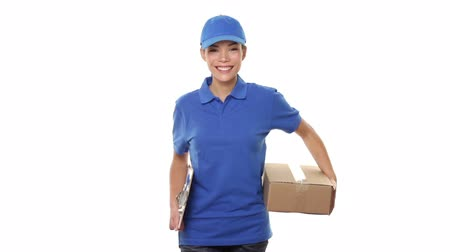 balík : Delivery person courier delivering packages holding clipboard and package smiling happy in blue uniform. Beautiful young Caucasian  Chinese Asian female professional courier on white background.