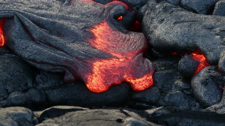 rocks red : Lava - flowing lava from Kilauea volcano, Big Island, Hawaii. Lava stream flowing in real-time from Kilauea volcano around Hawaii volcanoes national park, USA.