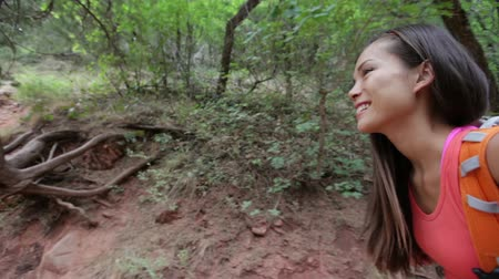 utazó : Woman hiking in forest. Female hiker walking with backpack smiling happy in Zion Canyon, Zion National Park, Utah, USA. Multicultural Asian Caucasian active girl living healthy lifestyle outdoors.