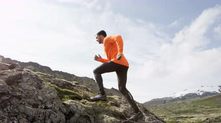 kimerül : Sport running man in cross country trail run. Fit male runner exercise training and jumping outdoors in beautiful mountain nature landscape with Snaefellsjokull  Snaefellsnes  Iceland. RED EPIC 90 FPS