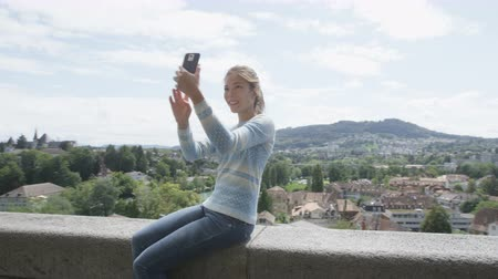 Картинки : Selfie woman - Tourist taking self portrait photography picture with smartphone and regular photo at view point in Bern  Switzerland. Smart phone and travel concept. REAL TIME RED EPIC.