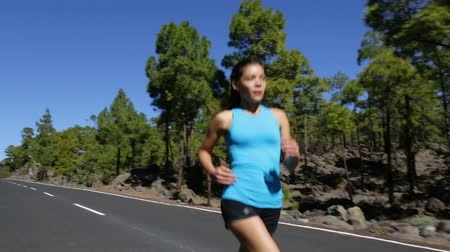 относящийся к разным культурам : Running woman exercising living healthy lifestyle jogging on mountain forest road. Sport runner girl on run outdoors working out. Fit young asian woman fitness model outside.
