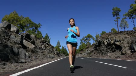 jogging : Woman running exercising living healthy lifestyle  jogging on mountain forest road. Sport runner girl on run outdoors working out. Fit young asian woman fitness model outside.