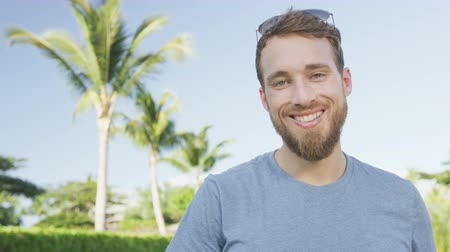broda : Young casual man with beard portrait happy smiling. Handsome young bearded man smiling happy outside looking at camera. Urban male hipster in his late 20s. RED EPIC 90 FPS.