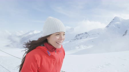 švýcarský : Woman walking in snow in Swiss alps Switzerland on top of Jungfrau mountain next to Aletsch glacier. Female hiker hiking in snowy landscape in summer in the Swiss alps. Mixed race Asian Caucasian girl Dostupné videozáznamy