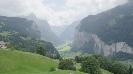 tájak : Landscape of Swiss Alps Lauterbrunnen valley in Switzerland, Europe in summer. Beautiful classic nature scenery from Bernese Oberland with mountains Jungfrau, Eiger and Monch in background.