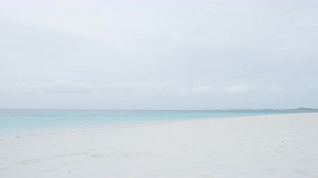 serene : Beach background calm and serene with nobody. Peaceful relaxing landscape with ocean sea and white sandy beach in the caribbean Stock Footage