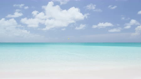 destinace : Beach vacation travel paradise destination background. Perfect white sand beach with turquoise water ocean and clear blue sky. RED EPIC SLOW MOTION,