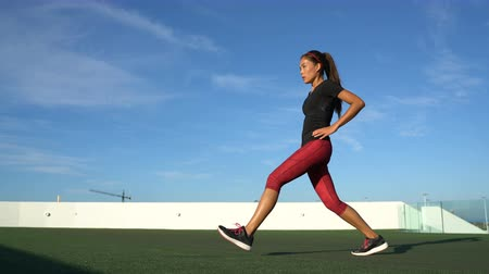 quads : Lunges exercises woman doing front lunge leg exercise workout for quads, thighs and calves strength training. Fitness woman exercising outside on grass.