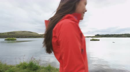 utazó : Active woman walking in nature hiking on Iceland hike. Hiker girl walking in outdoor clothing outside visiting Icelandic nature tourist destination landmarks. Lake Myvatn, Iceland