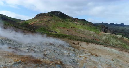 seltun : Iceland nature landscape drone video of geothermal fields showing volcanic activity of active volcano fumaroles. Seltun geothermal field in Krysuvik on Reykjanes peninsula, South West Iceland.