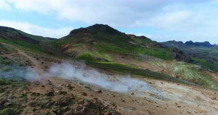 seltun : Iceland landscape nature drone video of volcano geothermal volcanic activity fields showing volcanic active fumaroles. Seltun geothermal field in Krysuvik on Reykjanes peninsula, South West Iceland. Stock Footage