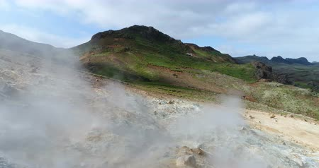 seltun : Iceland nature landscape drone footage of geothermal fields showing volcanic activity of active volcano fumaroles. Seltun geothermal field in Krysuvik on Reykjanes peninsula, South West Iceland.