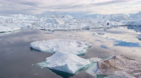climate : Iceberg and ice from glacier in arctic nature landscape on Greenland. Aerial video drone footage of icebergs in Ilulissat icefjord. Affected by climate change and global warming. Stock Footage