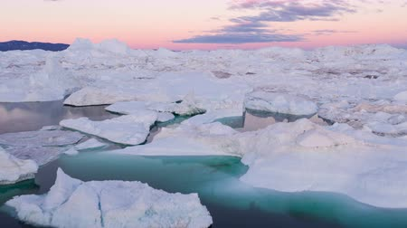 disko bay : Iceberg from glacier in arctic nature landscape on Greenland. Aerial video drone footage of icebergs in Ilulissat icefjord. Affected by climate change and global warming. Stock Footage