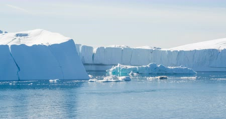 ilulissat : Greenland Iceberg landscape of Ilulissat icefjord with giant icebergs. Icebergs from melting glacier. Arctic nature. Stock Footage