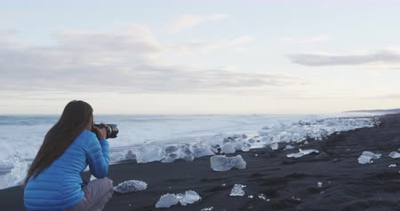 jokulsarlon : Nature Photography - Woman photographing landscape on Iceland, Diamond Beach with Ice, South Iceland. Stock Footage