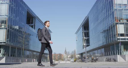 copenhagen : Business man. Young urban professional businessman walking to work wearing backpack wearing backpack. Businessman in 30s in Copenhagen, Denmark, Scandinavia. Stock Footage