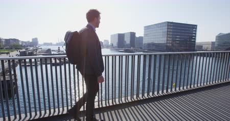 copenhagen : Young urban professional business man walking to work wearing backpack wearing backpack. Businessman in 30s in Copenhagen, Denmark, Scandinavia. Stock Footage
