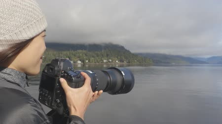 alaszka : Alaska tourist photographer enjoying travel vacation cruise in Misty Fiords National Monument (aka Misty Fjords) taking pictures photographing the travel adventure in Alaska.