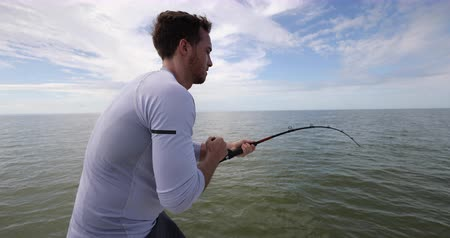 to bite : Fishing - man sport fishing big game shark fishing on boat in Florida. Travel tourist man catch and release of spinner shark. From Florida keys. Stock Footage