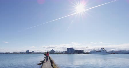 reykjavik : Reykjavik Iceland - view of city and cruise ship in Reykjavik Harbour. Tourist sightseeing on beautiful sunny summer day. RED EPIC SLOW MOTION. Stock Footage