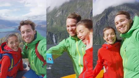 video reel : Happy couple taking selfie video on travel vacation New Zealand, Milford Sound in Fiordland National Park and Roys Peak New Zealand. Vertical video with Multicultural couple smilng having fun laughing Stock Footage