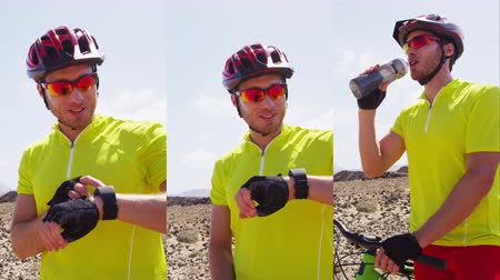 байкер : Vertical Videos: Mountain biking man using smartwatch sport watch looking at heart rate monitor fitness tracker resting during MTB bike ride in nature drinking water.