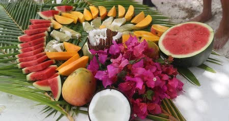 manga : Fruit arrangement - tahiti fruit table with coconut mango watermelon melons etc. Typical local tahitian food presentation from French Polynesia.