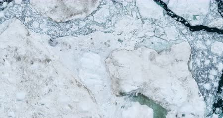 ilulissat : Icebergs drone aerial video top view - Climate Change and Global Warming - Icebergs from melting glacier in icefjord in Ilulissat, Greenland. Arctic nature ice landscape