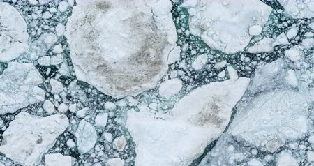 ilulissat : Climate Change and Global Warming - Icebergs drone aerial video top view. Icebergs from melting glacier in icefjord in Ilulissat, Greenland. Arctic nature ice landscape